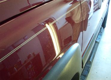 Dent on side of car removed